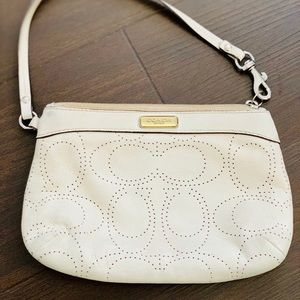 White leather coach clutch
